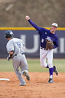 High Point Panthers shortstop Tony Fortier-Bensen (8) turns a double play against the UNCG Spartans at Willard Stadium on February 14, 2015 in High Point, North Carolina.  The Panthers defeated the Spartans 12-2.  (Brian Westerholt/Four Seam Images)