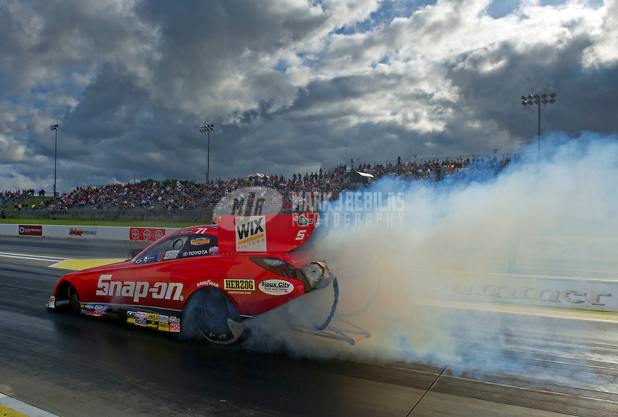May 20, 2011; Topeka, KS, USA: NHRA funny car driver Cruz Pedregon does a burnout during qualifying for the Summer Nationals at Heartland Park Topeka. Mandatory Credit: Mark J. Rebilas-