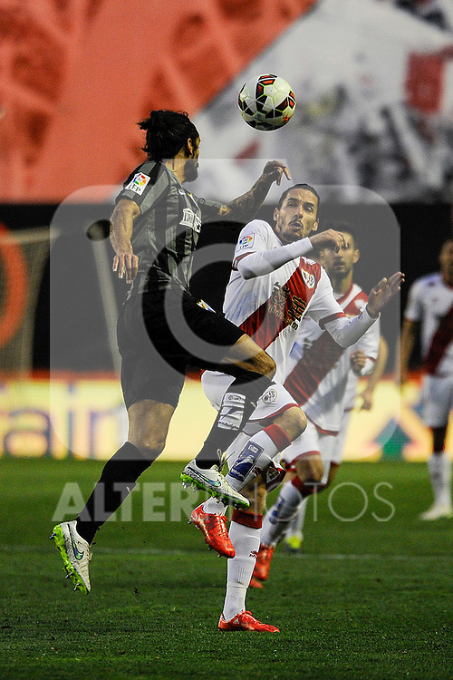 Rayo Vallecano´s Lica and Malaga CF´s Marcos Alberto Angeleri during 2014-15 La Liga match between Rayo Vallecano and Malaga CF at Rayo Vallecano stadium in Madrid, Spain. March 21, 2015. (ALTERPHOTOS/Luis Fernandez)