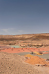 Israel, the Negev Desert. Colored sand by the pool in Ramon Crater