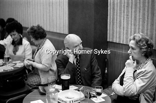 Couple out together Saturday night at the Coventry Working Mens Club, 1980s England. ..