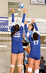 SIOUX FALLS, SD - SEPTEMBER 5: Jessica Mieras #22 and Dalee Stene #17 from O'Gorman smother a kill attempt by Steph Buss #9 from Lincoln in the third game of their match Thursday night at O'Gorman.  (Photo by Dave Eggen/Inertia)