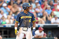 Michigan Wolverines designated hitter Jordan Nwogu (42) after scoring a run during Game 6 of the NCAA College World Series against the Florida State Seminoles on June 17, 2019 at TD Ameritrade Park in Omaha, Nebraska. Michigan defeated Florida State 2-0. (Andrew Woolley/Four Seam Images)