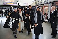 A group calling itself 'Muslims Against the Crusades' stage a provocative protest in Barking against a parade by the Royal Anglian Regiment who were being granted the freedom of the borough. There was a counter protest by the racist English Defence League and scuffles as the Police kept the two sides apart.
