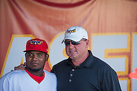 Roger Clemens, an 11-time All-Star, two-time World Series champion and seven time Cy Young Award winner poses with Eduar Lopez (26) of the Orem Owlz before the game against the Ogden Raptors in Pioneer League action at Home of the Owlz on June 20, 2015 in Provo, Utah.  The Raptors defeated the Owlz 9-6.  (Stephen Smith/Four Seam Images)