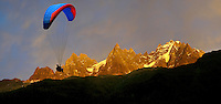 Paraglider at sunset on the Mont Blanc Massif - Chamonix Mont Blanc, France