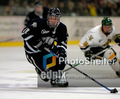 6 January 2007: University of New Hampshire forward Jerry Pollastrone (11) from Revere, MA, in action against the University of Vermont Catamounts at Gutterson Fieldhouse in Burlington, Vermont. The UNH Wildcats defeated Vermont 2-1 to sweep the two-game weekend series in front of a record setting 49th consecutive sellout at the Gut...Mandatory Photo Credit: Ed Wolfstein Photo.<br />