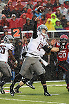 Connor Halliday fires a pass in heavy rain during the Washington State Cougars Pac-12 conference show down with the Utah Utes at Rice-Eccles Stadium in Salt Lake City, Utah, on September 27, 2014.  The Cougs came back from a 21-0 deficit to defeat the previously unbeaten Utes, 28-27.