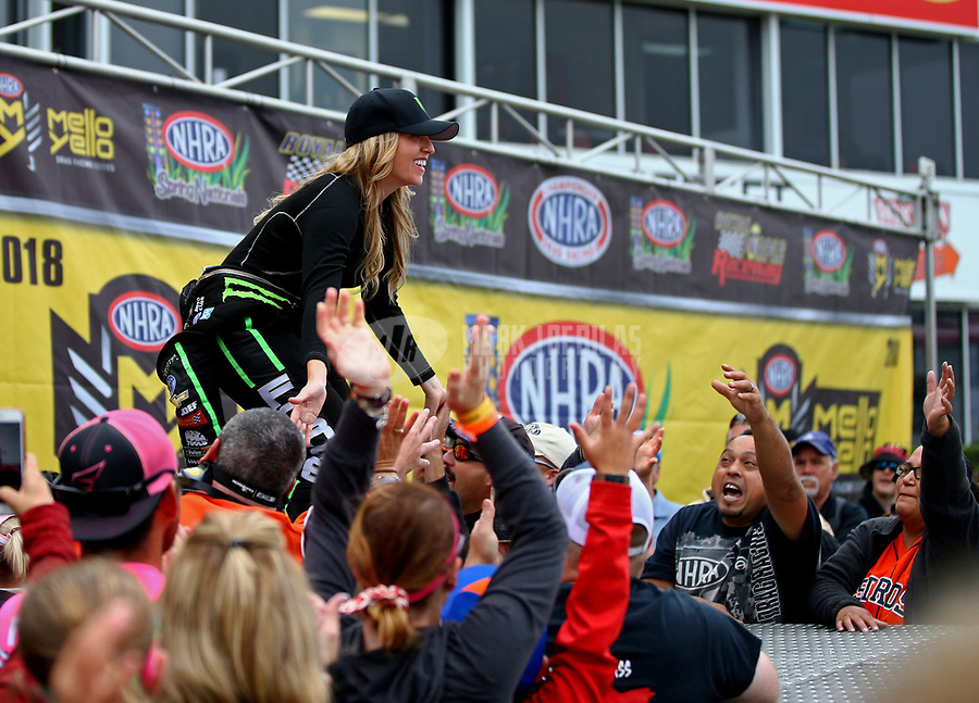 Apr 22, 2018; Baytown, TX, USA; NHRA top fuel driver Brittany Force greets fans at driver introductions prior to the Springnationals at Royal Purple Raceway. Mandatory Credit: Mark J. Rebilas-USA TODAY Sports