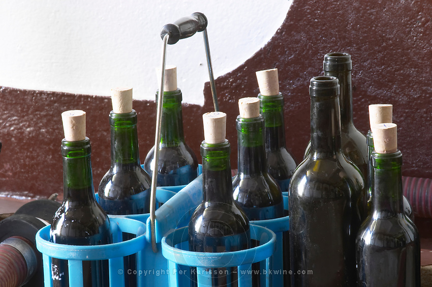 Transporting bottles in a carrying basket. Chateau la Grace Dieu les Menuts, Saint Emilion, Bordeaux, France