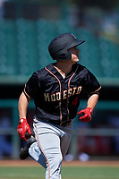 Modesto Nuts third baseman Matt Sanders (4) jogs down the first base line during a California League game against the Inland Empire 66ers on April 10, 2019 at San Manuel Stadium in San Bernardino, California. Inland Empire defeated Modesto 5-4 in 13 innings. (Zachary Lucy/Four Seam Images)