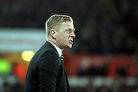 Pictured: An angry Swansea manager Garry Monk is protesting to the fourth official Saturday 10 January 2015<br />