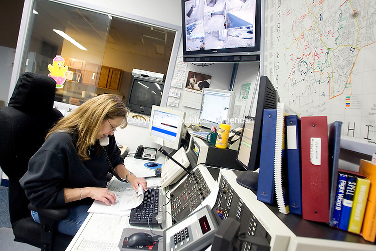 WATERTOWN, CT- 09 MARCH 2008- 030908JT01-<br /> Pat Bessette, a telecommunicator at the Watertown Police Department, takes a call at her job on Sunday afternoon. Bessette and the other Watertown telecommunicators have been given a 3.5 percent raise as part of a newly signed contract. <br /> Josalee Thrift / Republican-American