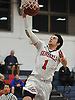 Kyle Acquavella #1 of MacArthur drives to the hoop for two points during a game against Hjemly (Ringe, Denmark) in the Jeff Shaw Memorial Basketball Tournament at MacArthur High School on Thursday, Dec. 1, 2016. He scored a game-high 17 points in MacArthur's 65-43 win.