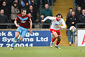 Lawrie Wilson of Stevenage and Eddie Nolan of Scunthorpe give chase. Scunthorpe United v Stevenage - npower League 1 - Glanford Park, Scunthorpe - 21st January, 2012. © Kevin Coleman 2012
