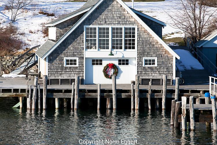 Christmas wreath on a boat house on Little Diamond Island, Casco Bay, Maine