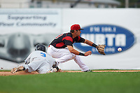Batavia Muckdogs shortstop J.J. Gould (49) stretches for a throw as Bill Pujols (3) dives back to second base during a game against the Hudson Valley Renegades on July 31, 2016 at Dwyer Stadium in Batavia, New York.  Hudson Valley defeated Batavia 4-1. (Mike Janes/Four Seam Images)