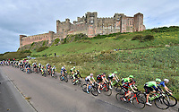 Picture by Allan McKenzie/SWpix.com - 04/09/2017 - Cycling - OVO Energy Tour of Britain - Stage 2 Kielder Water to Blyth - The peloton pass by Bamburgh Castle en route to finish at Blyth, Northhumberland