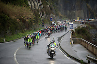 peloton racing along the Mediterranean on a rainy day<br /> <br /> 106th Milano - San Remo 2015