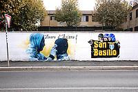 Titolo: Nessuno Artista Ignoto<br /> Title none, Artist Unknown<br /> Un murale sui tifosi della Lazio e la scritta San Basilio, nome del quartiere<br /> A Painting of Lazio fans<br /> Roma 17-11-2015 Street Art a Roma. In vari quartieri di Roma e' fiorita la Street Art, con splendidi murales che hanno lo scopo di raccontare delle storie della citta', di commemorare dei momenti importanti, o semplicemente di interpretarla.<br /> Street Art in Rome. Very important writers  painted Murales in various districts of Rome to tell stories about the city, to commemorate important moments, to embellish the quarter or simply to portray it.  <br /> Photo Samantha Zucchi Insidefoto