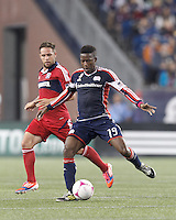 New England Revolution midfielder Clyde Simms (19) passes the ball. In a Major League Soccer (MLS) match, the New England Revolution (blue) defeated Chicago Fire (red), 1-0, at Gillette Stadium on October 20, 2012.
