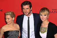 "NEW YORK, NY - NOVEMBER 20: Elizabeth Banks, Liam Hemsworth, Jennifer Lawrence at the New York Premiere Of Lionsgate's ""The Hunger Games: Catching Fire"" held at AMC Lincoln Square Theater on November 20, 2013 in New York City. (Photo by Jeffery Duran/Celebrity Monitor)"