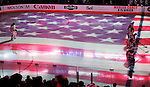 23 January 2010: With the US flag projected on the ice, the starting lineup of the New York Rangers stand during the singing of the American National Anthem: The Star Spangled Banner, prior to a game against the Montreal Canadiens at the Bell Centre in Montreal, Quebec, Canada. The Canadiens shut out the Rangers 6-0. Mandatory Credit: Ed Wolfstein Photo