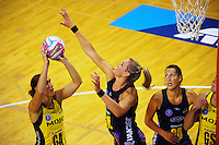 Jodi Brown shoots under pressure from Leana De Bruin during the ANZ Netball Championship match between the Central Pulse and Waikato Bay Of Plenty Magic at TSB Bank Arena, Wellington, New Zealand on Monday, 30 March 2015. Photo: Dave Lintott / lintottphoto.co.nz