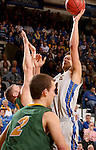 BROOKINGS, SD - FEBRUARY 14:  Cody Larson #34 from South Dakota State takes the ball to the basket against Dexter Werner #40 form North Dakota State in the second half of their game Saturday afternoon at Frost Arena. (Photo by Dave Eggen/Inertia)
