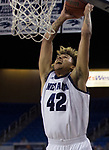 Nevada forward K.J. Hymes (42) dunks the ball against             Colorado Christian during the second half of an NCAA college basketball game in Reno, Nev., Wednesday, Oct. 30, 2019.