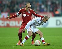 FUSSBALL  DFB POKAL       SAISON 2012/2013 FC Bayern Muenchen - 1 FC Kaiserslautern  31.10.2012 Arjen Robben (li, FC Bayern Muenchen) gegen Mimoun Azaouagh (1. FC Kaiserslautern)