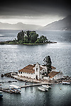Stormy skies over Vlacherna Monastery and Mouse Island in Corfu, Greece