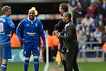 Coventry City 1 Birmingham City 1, 10/03/2012. Ricoh Arena, Championship. Former Coventry striker Marlon King (centre) sharing a joke with his manager Chris Hughton during the first half at the Ricoh Arena, as Coventry City hosted Birmingham City in an Npower Championship fixture. The match ended in a one-all draw, watched by a crowd of 22,240. The Championship was the division below the top level of English football. Photo by Colin McPherson.