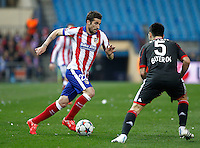 Atletico Madrid´s Spanish midfielder Cani and Leverkusen´s defense Emir Spahic