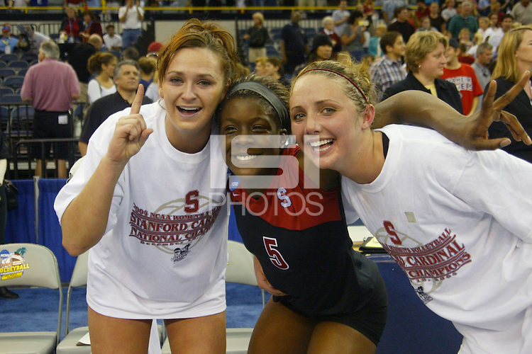 18 December 2004: Stanford Cardinal Katie Goldhahn and Njideka Nnamani and Kristin Richards during Stanford's  30-23, 30-27, 30-21 victory over Minnesota in the 2004 NCAA Women's Volleyball National Championships in Long Beach, CA. Stanford won their sixth women's volleyball title in school history.<br />