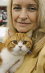 C'Anne Chavaneau from Austin holds her British Short Hair cat, Regatta Red at the Houston Cat Club's 56th Annual Charity Cat Show at the George R. Brown Convention Center this weekend with more than 384 cats in the competition. (Sunday, Jan. 6, 2008, in Houston. ( Steve Campbell / Chronicle)