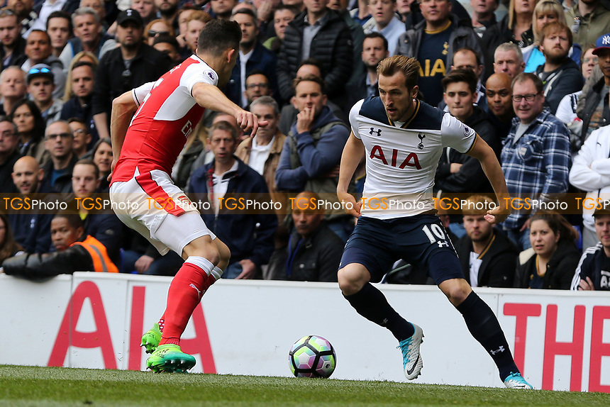 Harry Kane of Tottenham Hotspur and Gabriel Paulista of Arsenal during Tottenham Hotspur vs Arsenal, Premier League Football at White Hart Lane on 30th April 2017