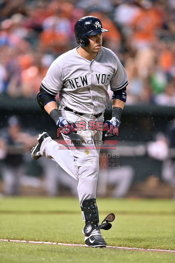 New York Yankees designated hitter Carlos Beltran #36 runs to first during a game against the Baltimore Orioles at Oriole Park at Camden Yards August 11, 2014 in Baltimore, Maryland. The Orioles defeated the Yankees 11-3. (Tony Farlow/Four Seam Images)