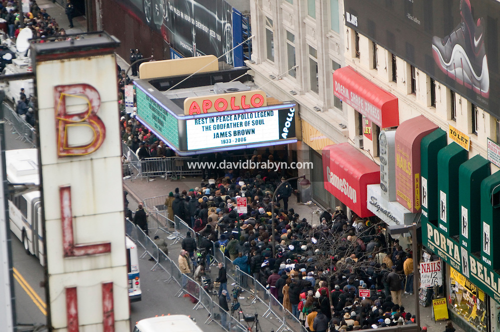 "28 December 2006 - New York City, NY - People line up outside the Apollo theater on 125th street in Harlem, New York City, USA, to see the body of singer James Brown lying in wake inside. Brown, known as the ""Godfather of Soul"" died on Christmas Day."