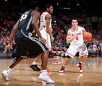 Ohio State Buckeyes guard Aaron Craft (4) drives around the perimeter with a pick from center Amir Williams (23) during the second half of the NCAA men's basketball game between the Ohio State Buckeyes and the Purdue Boilermakers at Value City Arena in Columbus, Ohio, on Saturday, Feb. 8, 2014. The Buckeyes defeated the Boilermakers, 67-49. (Columbus Dispatch/Sam Greene)
