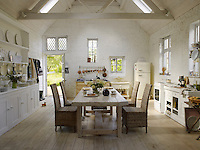 In the airy kitchen a large Welsh dresser, old-fashioned Aga and a long refectory table surrounded by rattan chairs have resulted in a cosy, rustic feel