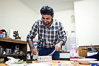 GERMANY, Pulheim: Abu Ali making food in the kitchen of his house in Pulheim. While arriving in Germany and after staying a week in a refugee camp, he and his family has obtained a 3 years refugee status in Germany.