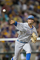 UCLA Bruin pitcher Adam Plutko (9) makes a pickoff attempt during Game 4 of the 2013 Men's College World Series against the LSU Tigers on June 16, 2013 at TD Ameritrade Park in Omaha, Nebraska. UCLA defeated LSU 2-1. (Andrew Woolley/Four Seam Images)