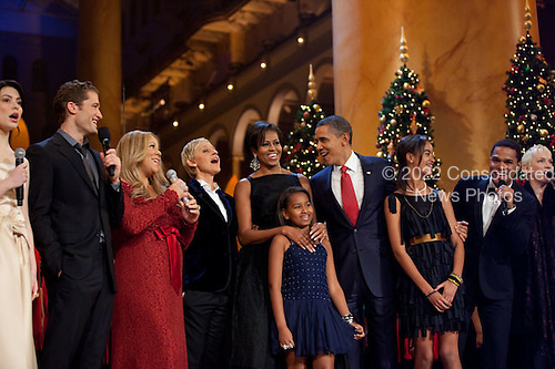 """United States President Barack Obama, First Lady Michelle Obama, and daughters Sasha and Malia sing """"Hark the Herald Angels Sing"""" with other performers onstage at the """"Christmas in Washington"""" performance at the National Building Museum in Washington, D.C., December 12, 2010. .Mandatory Credit: Pete Souza - White House via CNP"""