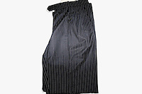 A pair of striped men's trousers is one of a number of items of clothing and objects found in an Islamic clothing and accessory shop in the Bagicilar district of Istanbul.