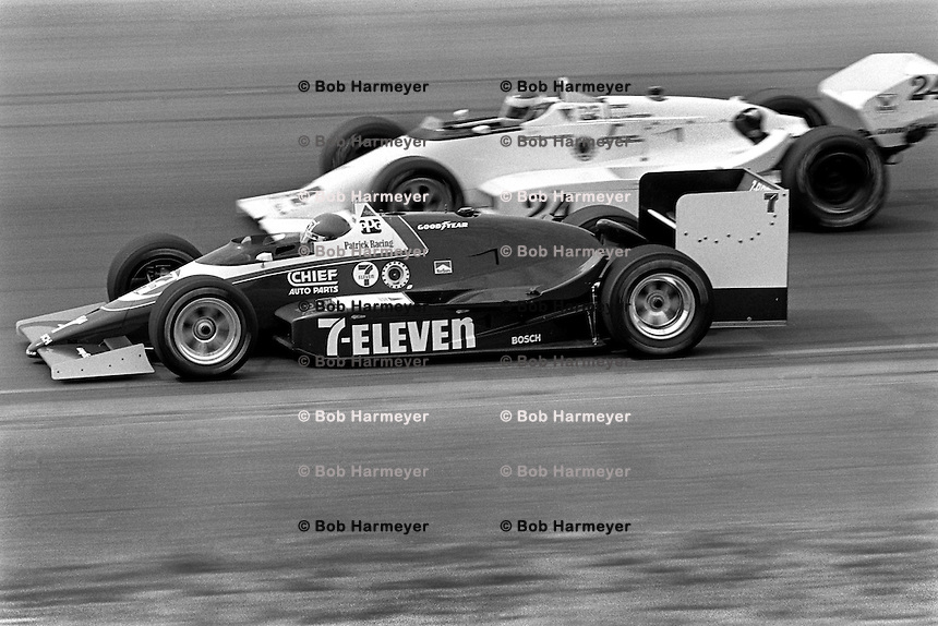 PHOENIX, AZ - APRIL 6: Kevin Cogan drives his Patrick Racing March 86C/Cosworth below Gary Bettenhausen in a March 85C 34/Cosworth en route to victory in the Dana 200 CART Indy Car race at the Phoenix International Raceway near Phoenix, Arizona, on April 6, 1986.
