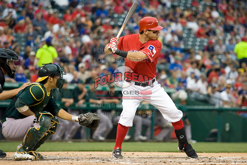 Texas Rangers second baseman Ian Kinsler (5) at bat against the Oakland Athetics in American League baseball on May 11, 2011 at the Rangers Ballpark in  Arlington, Texas. (Photo by Andrew Woolley / Four Seam Images)