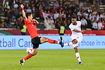 Abdel Aziz Hatim of Qatar (R) fights for the ball with Jung Wooyoung of South Korea (L) during the AFC Asian Cup UAE 2019 Quarter Finals match between Qatar (QAT) and South Korea (KOR) at Zayed Sports City Stadium  on 25 January 2019 in Abu Dhabi, United Arab Emirates. Photo by Marcio Rodrigo Machado / Power Sport Images