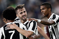 Calcio, Serie A: Torino, Allianz Stadium, 23 settembre 2017. <br /> Juventus' Miralem Pjanic (c) celebrates after scoring with his teamates during the Italian Serie A football match between Juventus and Tori0i at Torino's Allianz Stadium, September 23, 2017.<br /> UPDATE IMAGES PRESS/Isabella Bonotto