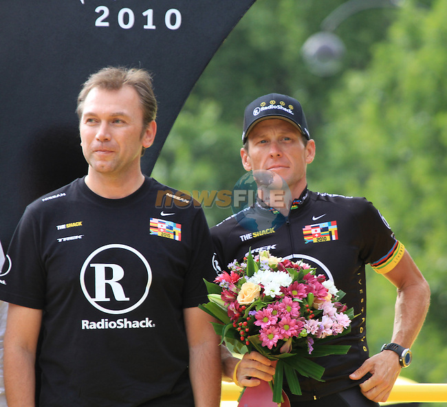 Lance Armstrong (USA) RadioShack and team manager Johan Bruyneel on the podium for the winning team presentation of the 2010 Tour de France on the Champs Elysee, Paris, 24th July 2010 (Photo by Eoin Clarke/NEWSFILE)